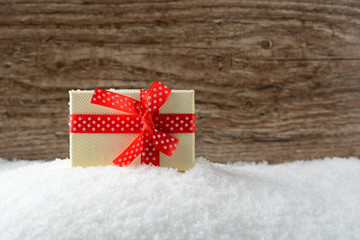 Box with a gift on snow