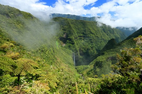 Seen on the Trou de fer waterfall on Reunion Island National Park with cloudscape, France , october 2016
