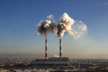 the smoke from the pipe of the plant, the emission  harmful gases into the atmosphere, greenhouse efekt