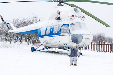 Small kid and helicopter