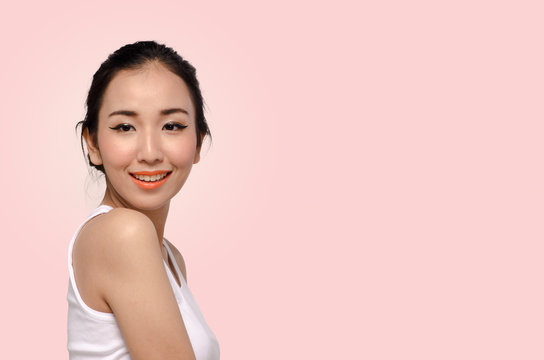 Portrait of Beautiful Young Woman On Beige background