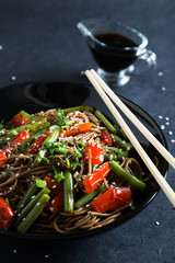 Soba with vegetables and sesame seeds. Noodles with vegetables