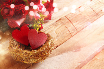 Beautiful bouquet of roses and couple of red hearts
