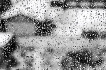 Texture Raindrops on window glass for rain, black and white colors, photo, unusual background