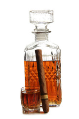 Decanter of whiskey and cigar on a white background