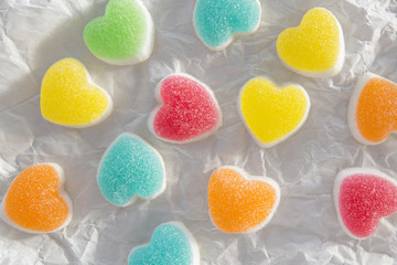colorful heart sign jelly candy on crumpled paper