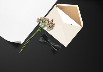 Envelope and flower stage with bow tie