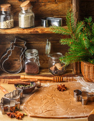 Making traditional gingerbread. Christmas. New year. Raw dough, cutting cookie and condiments on the table - anise, cloves, cardamom, cinnamon. Rustic style. Selective focus
