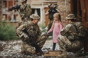 Rangers and children on battlefield background.