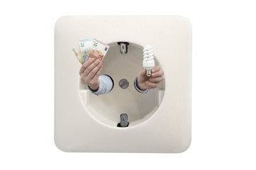 Close up of wall socket with man's hands holding euros and energy efficient light bulb