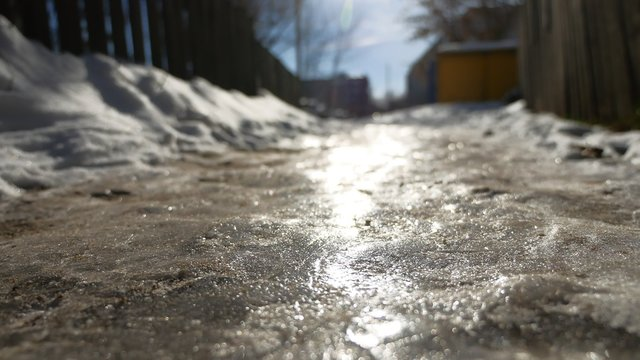 footpath in the city of ice and snow is slippery winter frozen