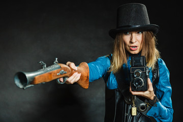 Steampunk with old retro camera and pistol.