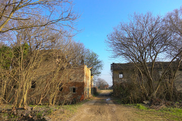 Abandoned old rural building in a sunny day in autumn