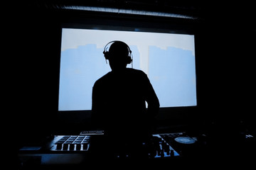 Back light DJ with headphones