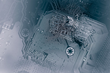 computer motherboard in dark colors as a background for your IT technology presentation