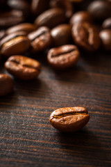 Coffee beans on a dark background. Vertical edit.