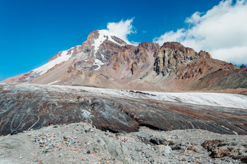 Mount Kazbek and dirty Gergeti glacier near Stepantsminda, Georgia