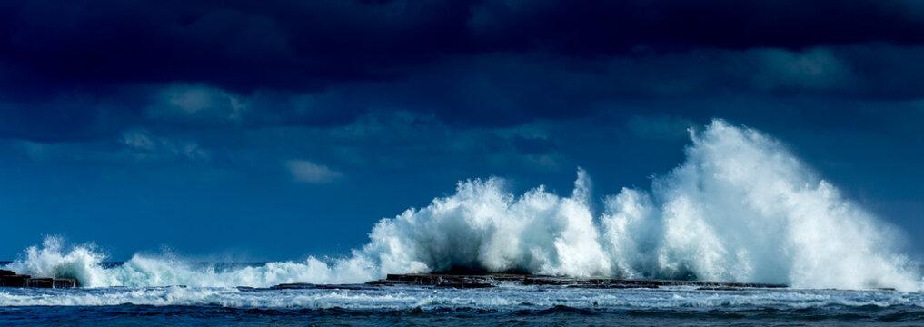 Waves crashing high at Coledale