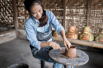 woman artist making pottery