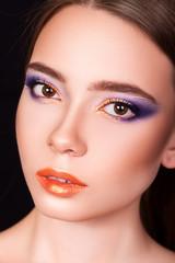 beautiful young girl on a black background, makeup, closeup