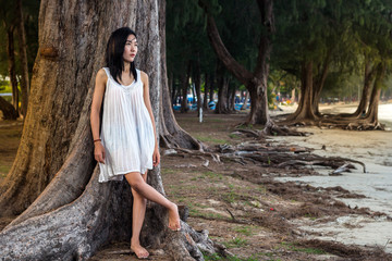 Portrait of beautiful young asian woman summer vacation on beach