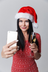 Brunette in Christmas photographing herselves