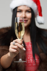 Christmas girl with champagne glass