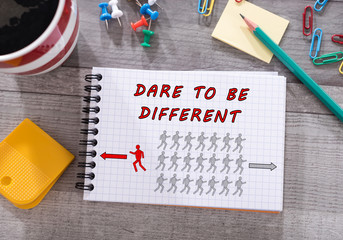 Dare to be different concept on a notepad