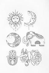 Sketch of elephant sun flower hamsa moon white background.