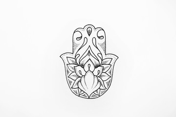 Sketch of hamsa with patterns on a white background.