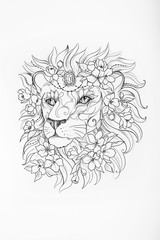 Sketch of lion's head in flowers on white background.