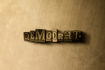 DEMOCRAT - close-up of grungy vintage typeset word on metal backdrop. Royalty free stock - 3D rendered stock image.  Can be used for online banner ads and direct mail.