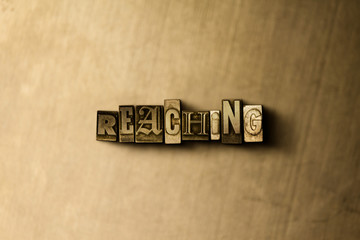 REACHING - close-up of grungy vintage typeset word on metal backdrop. Royalty free stock - 3D rendered stock image.  Can be used for online banner ads and direct mail.