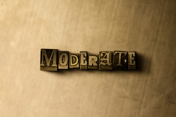 MODERATE - close-up of grungy vintage typeset word on metal backdrop. Royalty free stock - 3D rendered stock image.  Can be used for online banner ads and direct mail.