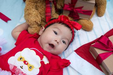Cute little girl newborn with teddy bear and gift box
