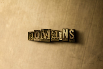 DOMAINS - close-up of grungy vintage typeset word on metal backdrop. Royalty free stock - 3D rendered stock image.  Can be used for online banner ads and direct mail.