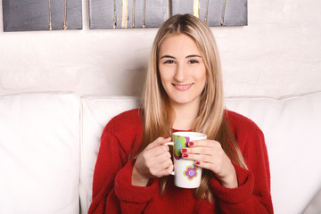 Young woman with a cup of coffee.