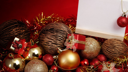 Christmas items in red and gold theme with white board standing for write word to merry Christmas and Happy New Year