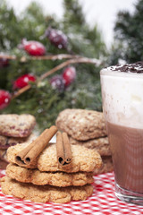 Hot chocolate in a cup and biscuits