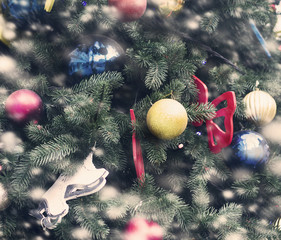 Christmas tree with ornaments and garlands of toys