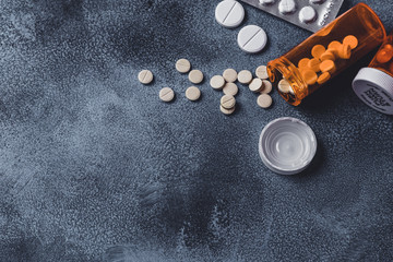 Top view of medicine Pills and tablets with orange pill bottles for healthcare.