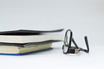 glasses and book isolated on white background.