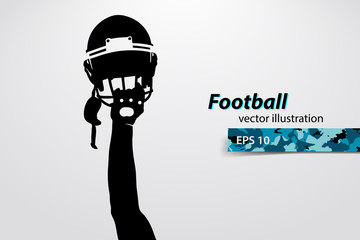 football helmet and hand silhouette. Rugby.