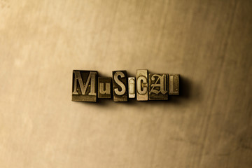 MUSICAL - close-up of grungy vintage typeset word on metal backdrop. Royalty free stock - 3D rendered stock image.  Can be used for online banner ads and direct mail.