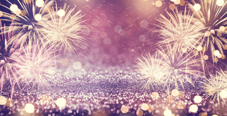 Fototapete - Gold and purple Fireworks and bokeh in New Year eve and copy space. Abstract background holiday.