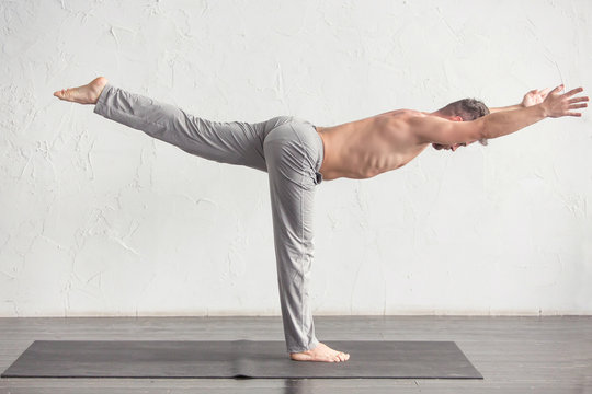 A man doing yoga exercises