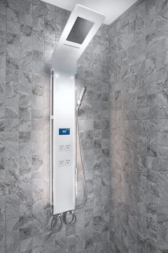 close up view of smart electronic shower panel in tiled room