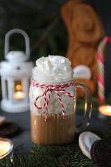 Christmas hot chocolate with ornaments and candy cane. Christmas and New Year decorations