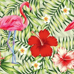Beautiful bird pink flamingo, hibiscus and frangipani flower on a background of green palm leaves. Seamless vector hawaii print wallpaper pattern