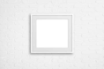 Blank frame on white bricks textured wallpaper, interior mock up